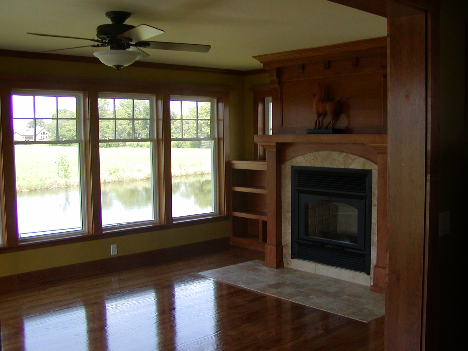 home town restyling sunroom addition with fireplace and windows