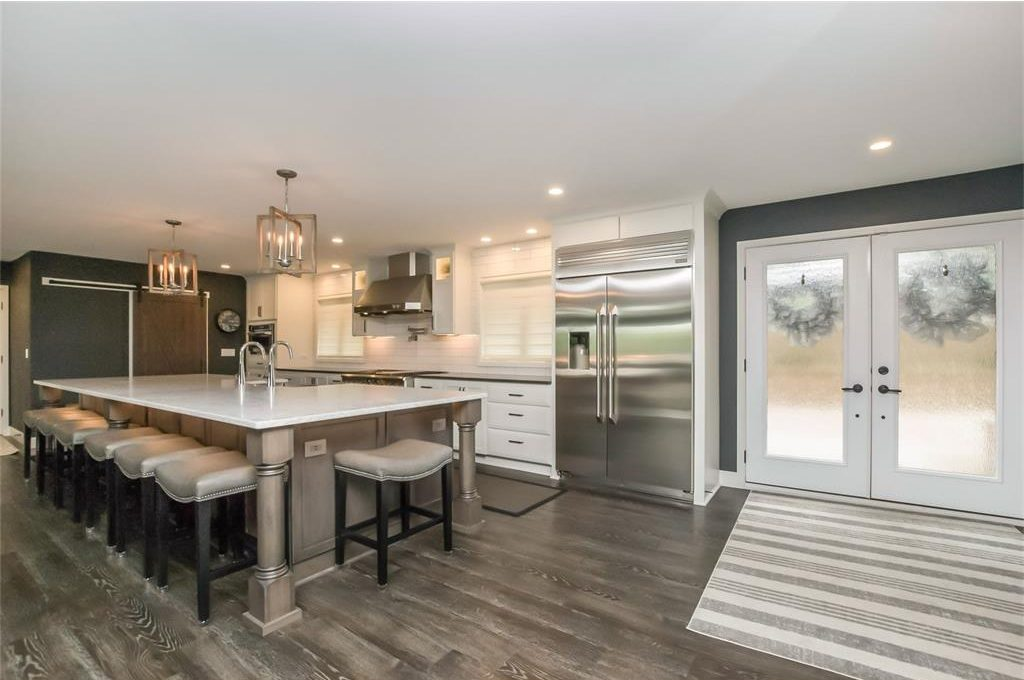 A kitchen remodeling project done in white and gray.