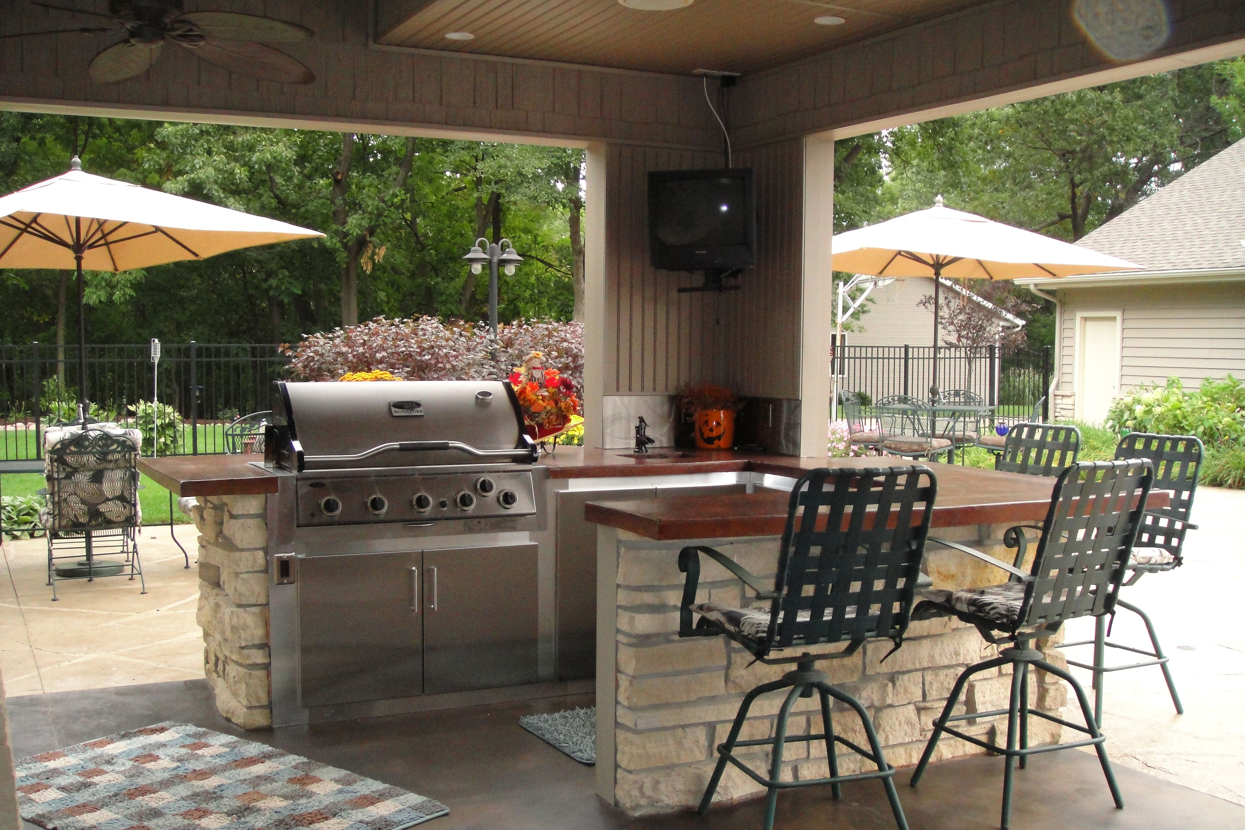 Aside from maintenance-free deck, you can also turn your outdoor living spaces into a kitchen area.